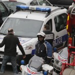 Policemen work at the scene after a shooting at the Paris offices of Charlie Hebdo, a satirical newspaper,